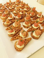 Smoked salmon on sweet potato waffles w caper cream & dill
