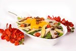 Chicken and Mango Salad with cherry tomatoes, Cajun macadamias, mesculin and sweet sesame dressing - Salad catering